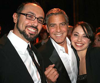 Yoav Potash celebrates with his wife Shira Potash and actor George Clooney